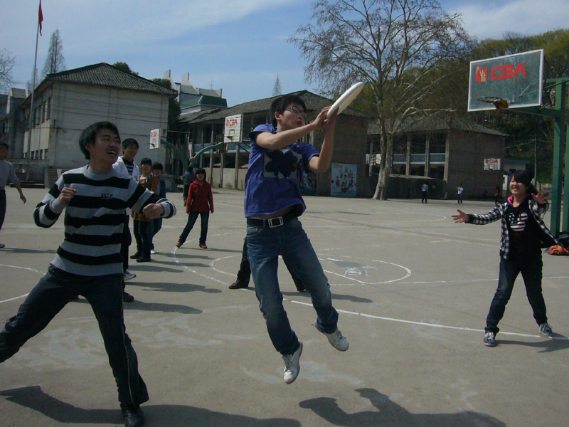 Senior 2 student Daniel catches some air for the Frisbee.